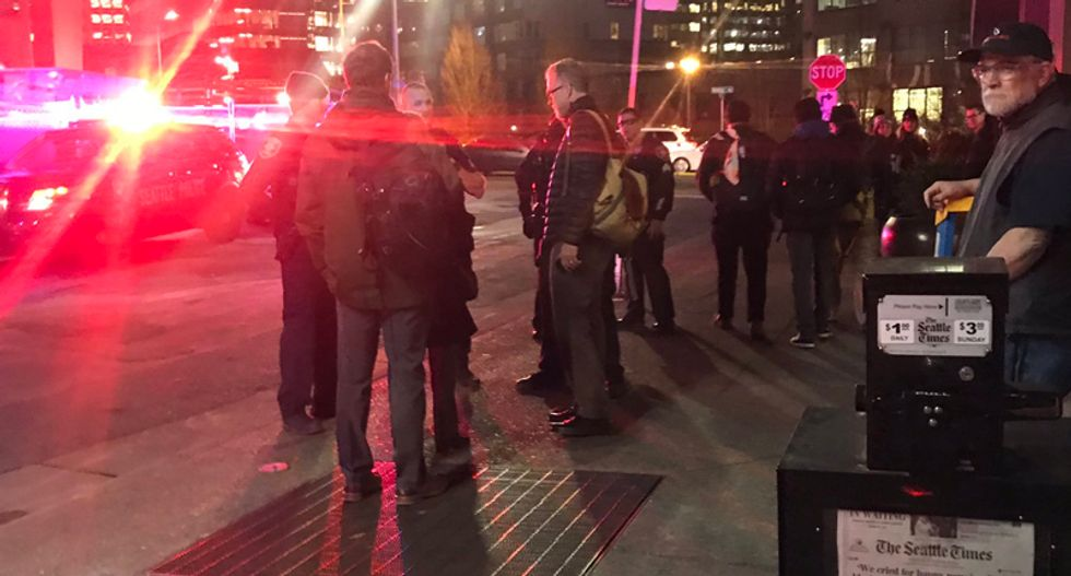 Seattle Times evacuated after bomb threat — journalists worked on the sidewalk to get the newspaper out