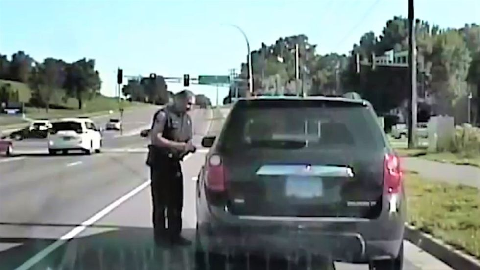WATCH: Cop busts woman for texting and driving while texting her friend about anti-text-and-driving laws