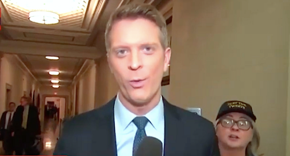 Crazed 'MAGA mom' interrupts MSNBC live shot to rant about impeachment 'coup'