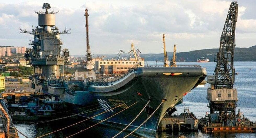 Russia's only aircraft carrier bursts into flames while sitting in port