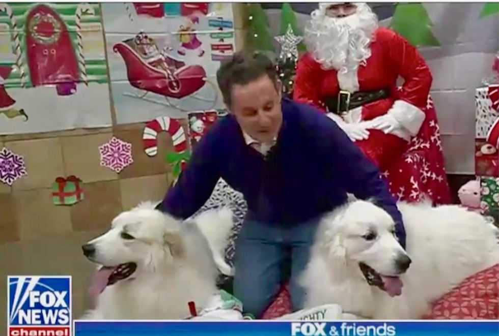 Fox & Friends suspends impeachment coverage to show footage of host visiting Santa with his dogs
