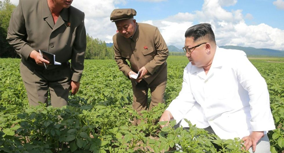 North Korea warns of food crisis, almost halves rations before summit