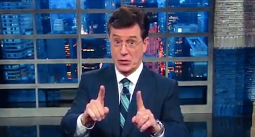 Colbert throws support behind Kaepernick's right to free speech -- and explains why the national anthem is just 'marketing'