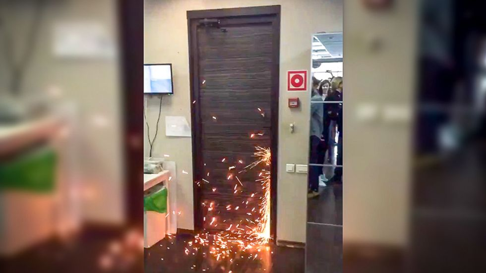 Pro-Putin forces raid Russian anti-corruption offices and detain leader moments before YouTube broadcast