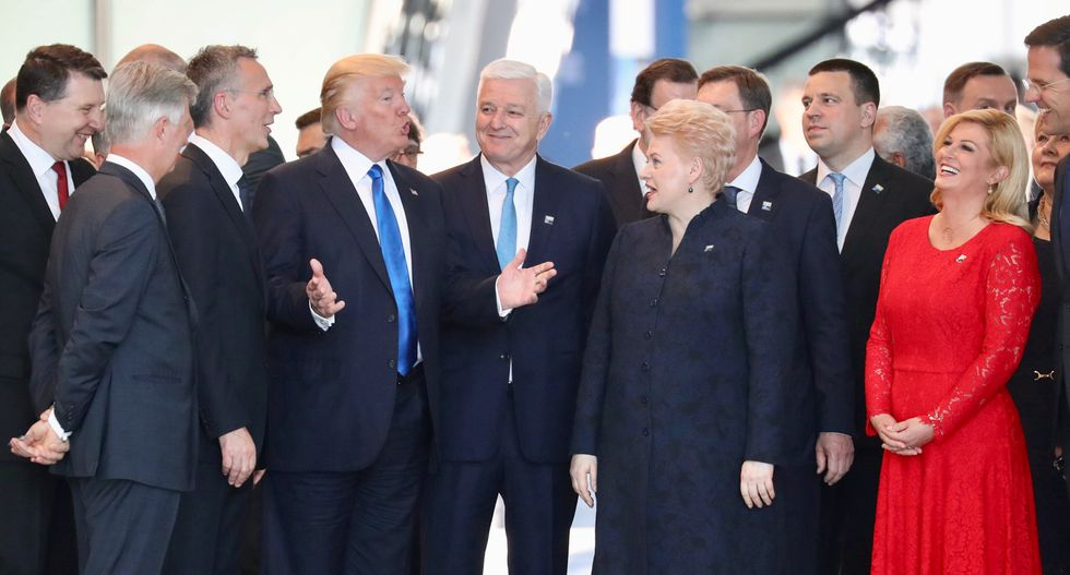 Video shows Trump shoving fellow NATO leader at his first summit