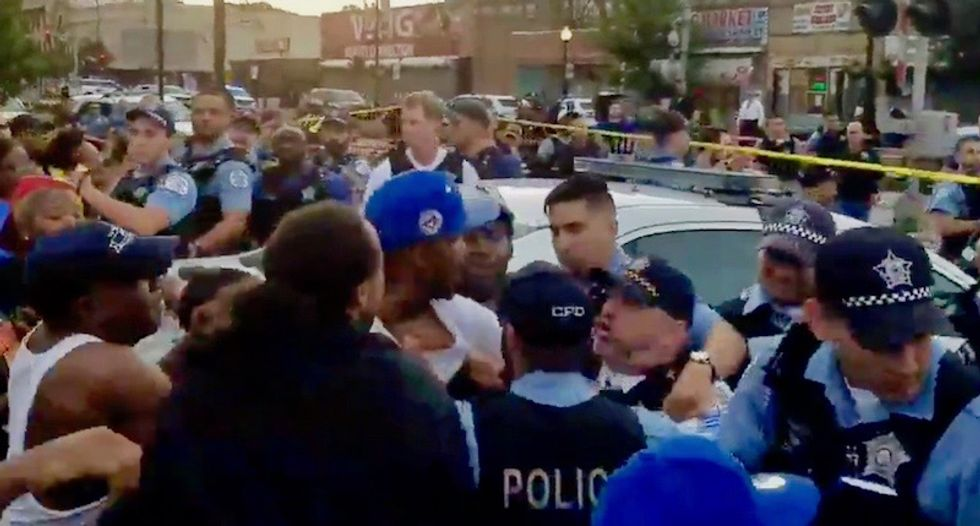 WATCH: Street protests erupt in Chicago after police officer reportedly shoots black man in back as he was fleeing