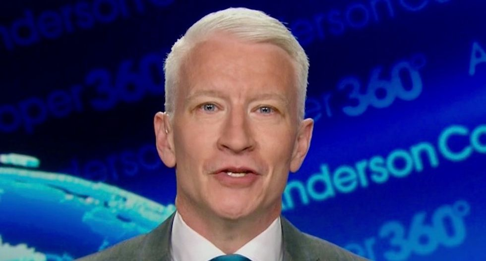 Watch CNN's Anderson Cooper hilariously rake Trump over the coals for living in a 'witch hunt' fantasy world
