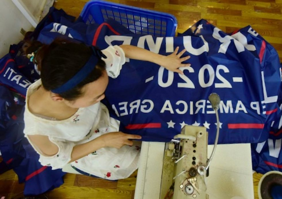 As trade war rages, Trump flags fly out of China factory
