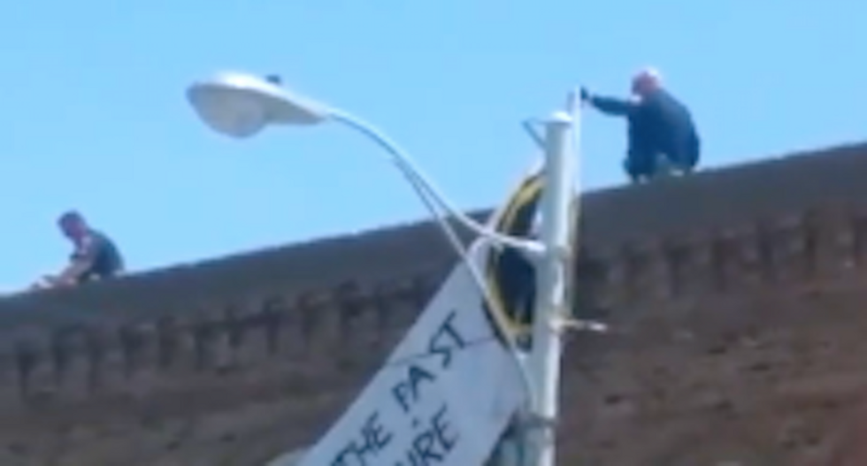 Marines arrested after displaying white nationalist banner at pro-Confederate rally