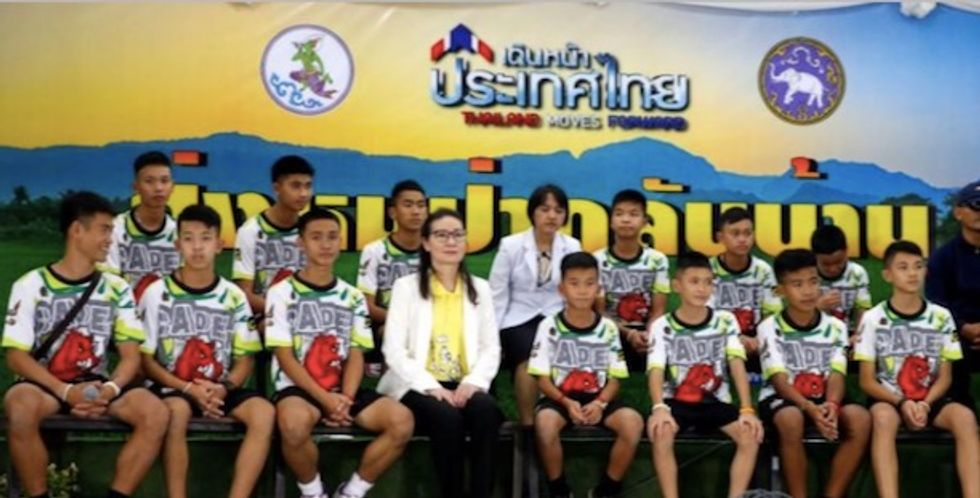 Thai cave boys wave and smile in first public appearance after rescue