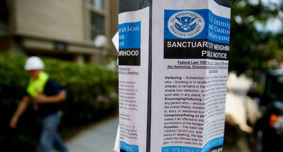 Signs of the time: Fake US immigration control posters found in Washington