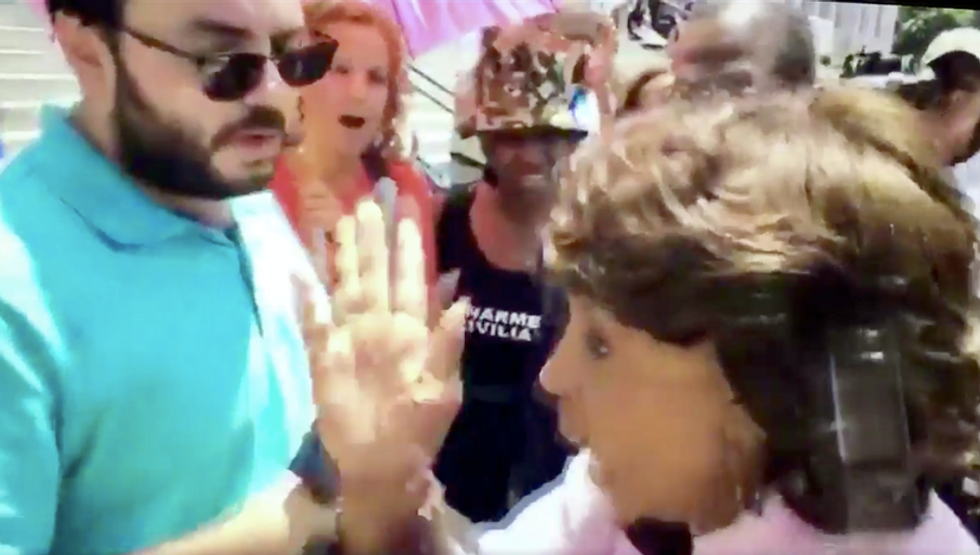 Did Maxine Waters 'shove' this Young Turks reporter? Watch and decide