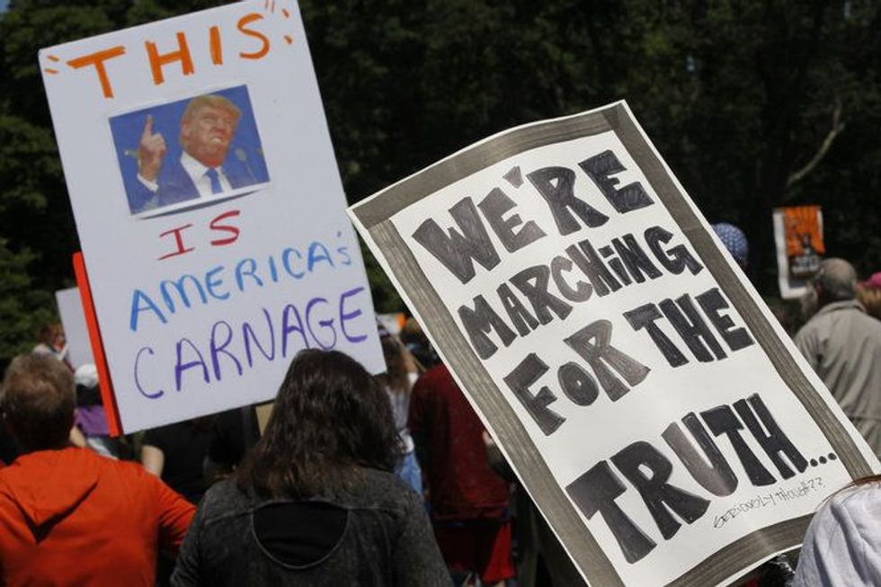 Protesters form anti-Trump motorcade near president's New Jersey golf club