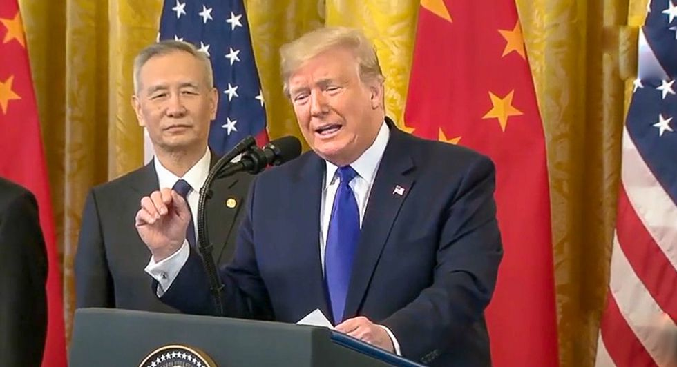 Trump cries 'impeachment hoax' at China trade deal signing as House debates sending articles to Senate