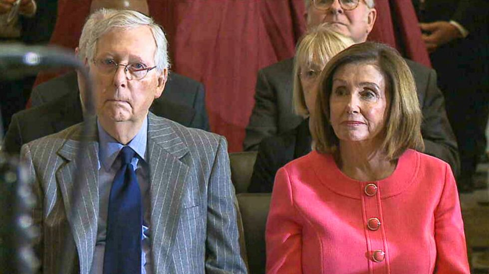 Nancy Pelosi and Mitch McConnell awkwardly sit together at ceremony after House ends impeachment stalemate