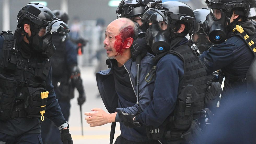 Police officers beaten after police disband Hong Kong democracy rally