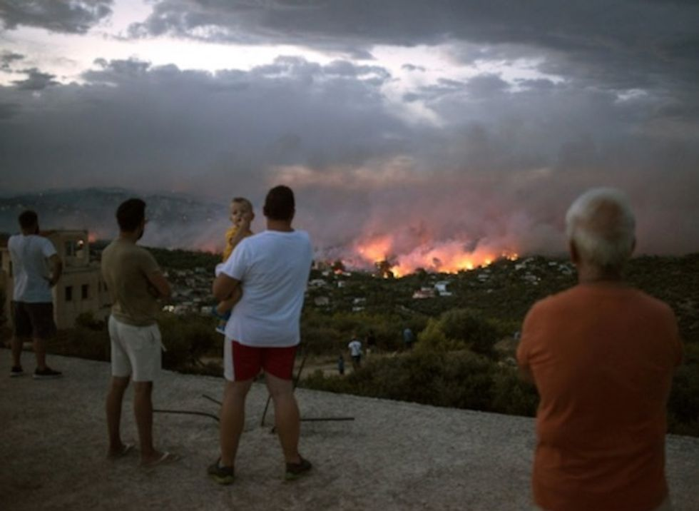 Greek wildfires kill 50 as resort 'no longer exists'