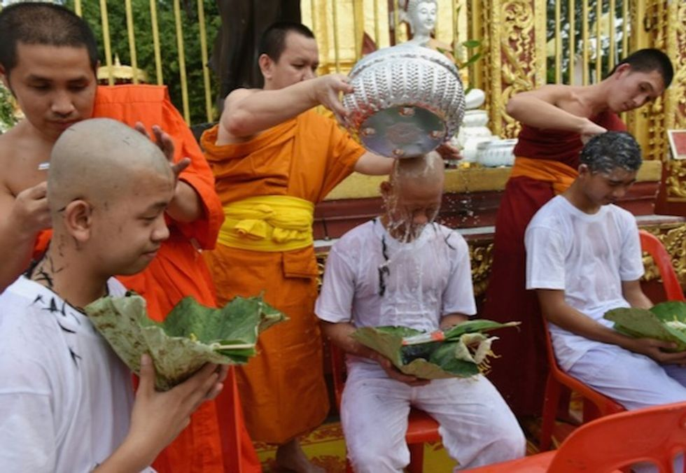 Thais rescued from cave shave heads ahead of ordination ceremony