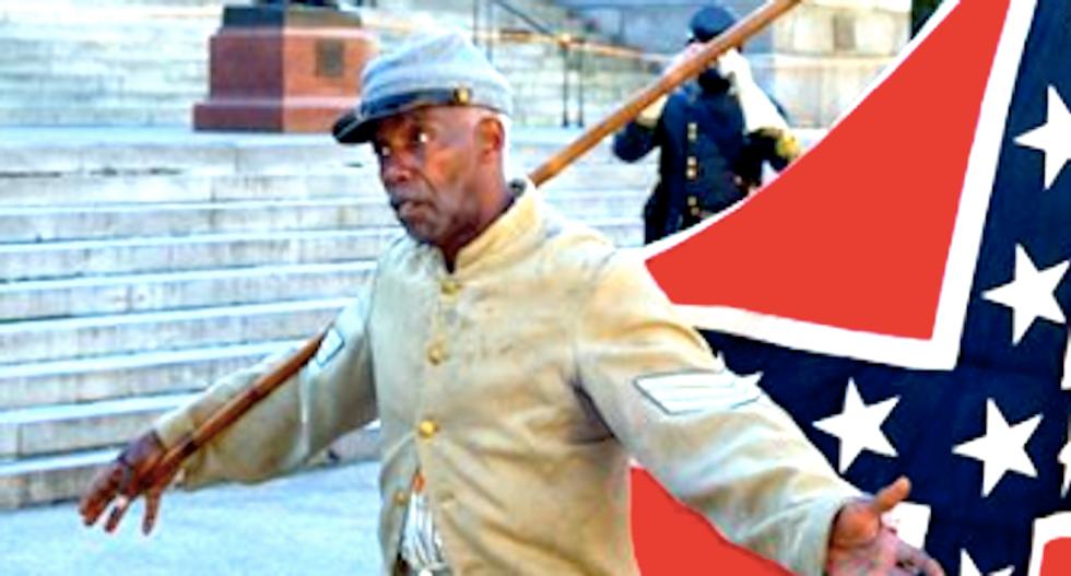 Bystanders break up bizarre scuffle between angry KKK members and black pro-Confederate activist