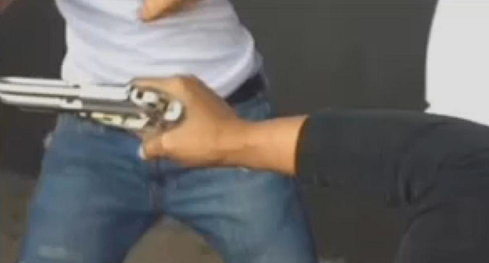 WATCH: Mom pulls gun on high school students during a schoolyard fight