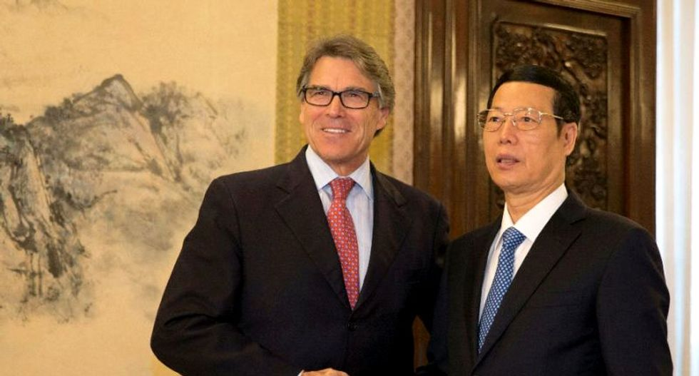 Rick Perry backs clean energy cooperation with China after Trump withdraws from Paris Agreement
