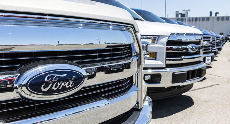 Ford cuts 2018 profit forecast after Trump tariffs and China sales hurt second quarter