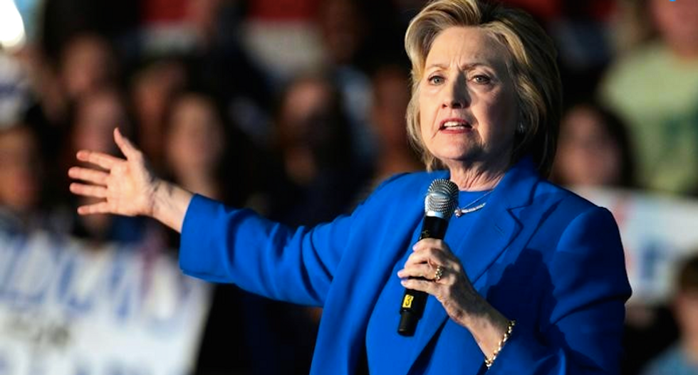 Clinton calls on world to break down barriers holding back girls