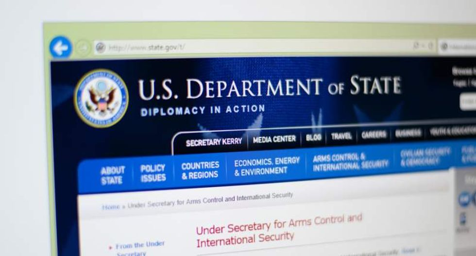 State Dept. employee charged in making contacts with Chinese agents
