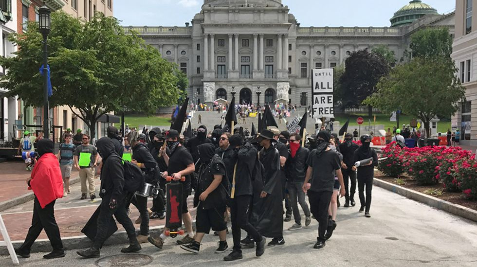 Anti-Muslim protesters march against Islamic law in dozens of US cities