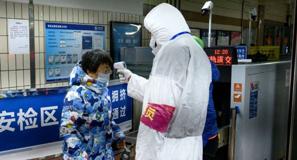 Virus death toll surges as China hurries to change the way it counts cases