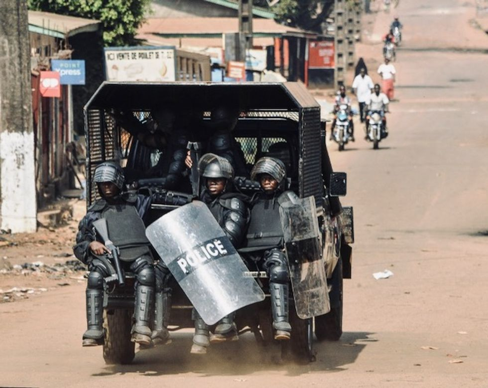 Outcry in Guinea over police using woman as 'human shield' video