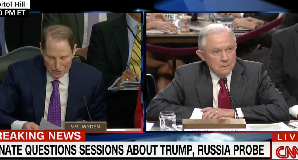 'Americans are sick of stonewalling': Sen. Wyden corners a seething Sessions over Comey's firing