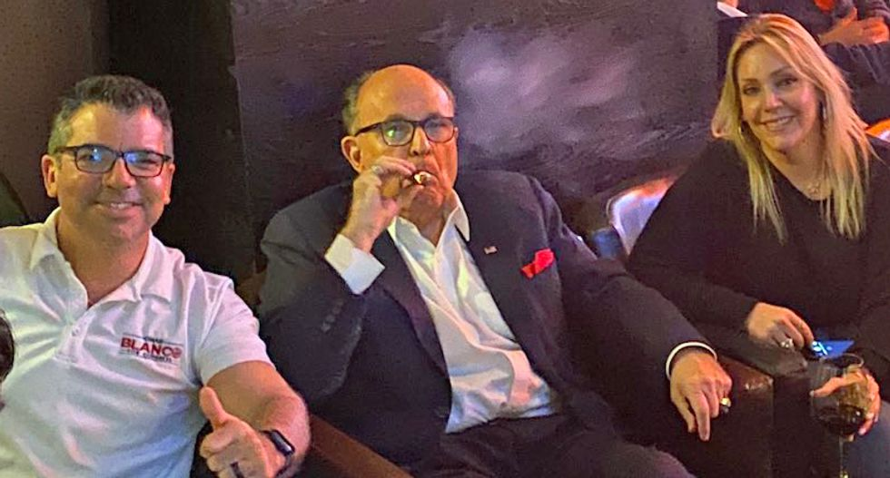 Rudy Giuliani posted celebratory pics of him sucking on cigars after GOP blocked impeachment witnesses