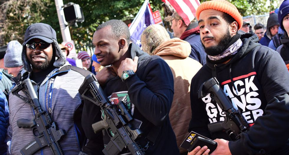 Militia groups spurn alt-right 'trash' at Virginia gun rally while establishing a dialogue with militant leftists