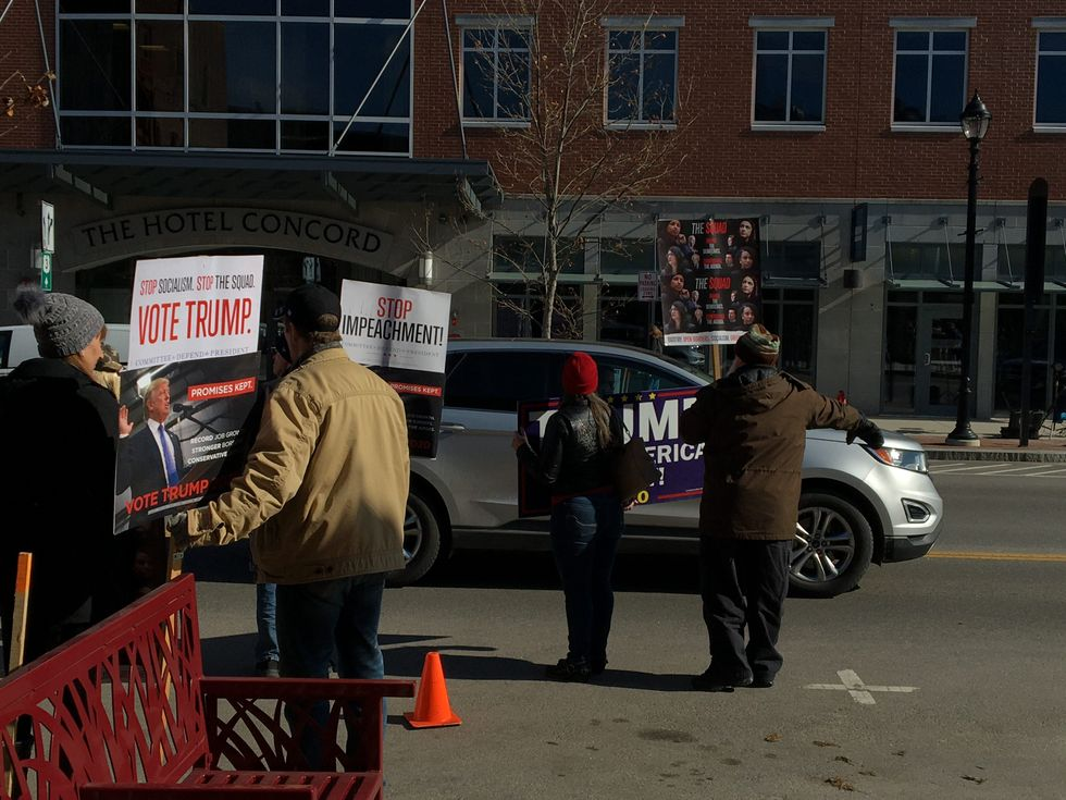 Pro-Trump Super PAC and 7 protesters bash Romney and Biden -- and try to 'stop the squad' -- at New Hampshire 2020 town hall