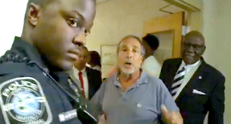 'It's a police state': School board meeting goes off the rails after first black principal reassigned