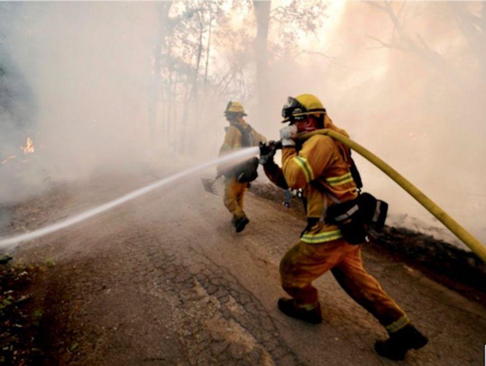 Milder temperatures help firefighters gain on massive California wildfire