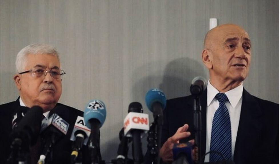 Israel ex-PM Ehud Olmert defiantly rallies behind Palestinian leader