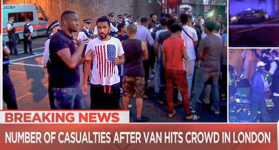 They hate us for our freedoms? Muslim mourner at scene of London attack wears American flag t-shirt