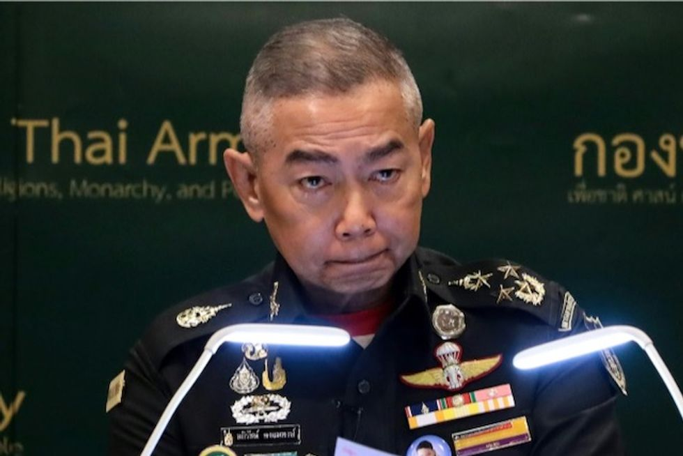 Tearful Thai general says 'don't blame army' for soldier's rampage