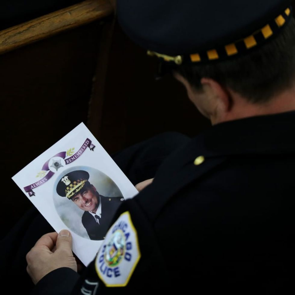 Family of Chicago police commander killed on duty sues online gun dealer