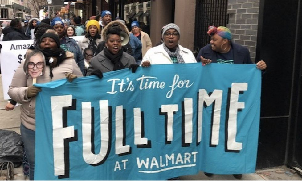 Walmart workers demand fair pay and hours at protest outside Alice Walton's penthouse as retail giant cuts jobs