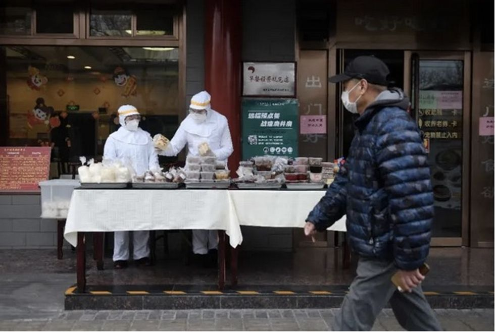 China virus cases rise again, Trump urges calm after US death