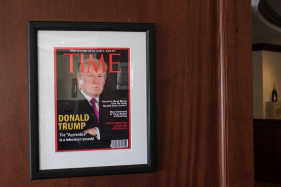 Trump's golf courses have framed copies of a fake Trump Time Magazine cover mounted on their walls
