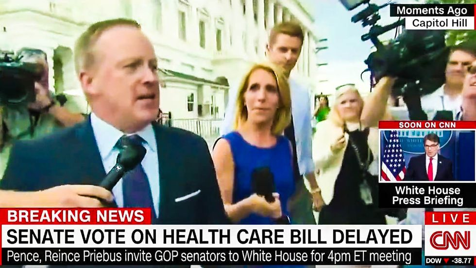 WATCH: Flustered Sean Spicer tries to flee reporters as he rushes back to the White House on foot