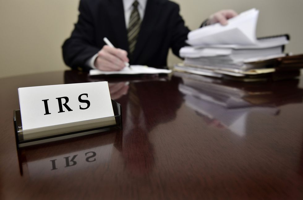 Whistleblower accuses IRS of tipping off members of Congress to corporate takeovers so they could score profits