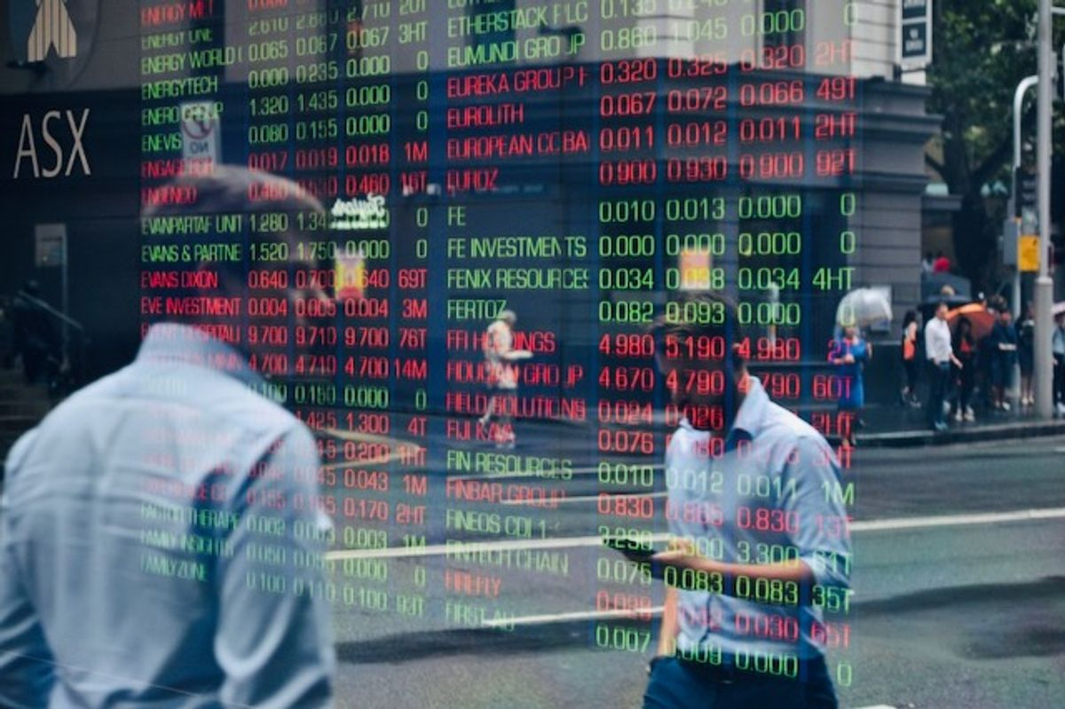 A year after crash, markets boom but bust fears loom