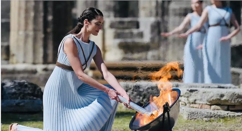 Greece hands over Olympic flame to Tokyo 2020