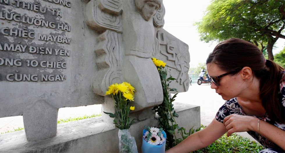 Flowers and tributes offered for McCain at Vietnam War crash site