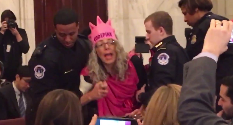 Charges dropped against woman who laughed at Trump nominee Sessions